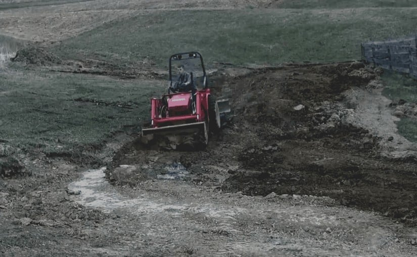 Kubota b20 digging storm ditch
